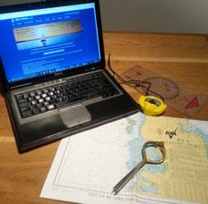 Laptop, Compass & Essential Navigation Charts